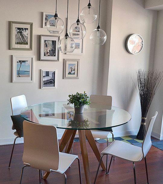 Mesas imprescindibles el centro neur lgico de la decoraci n - Salon comedor con mesa redonda ...