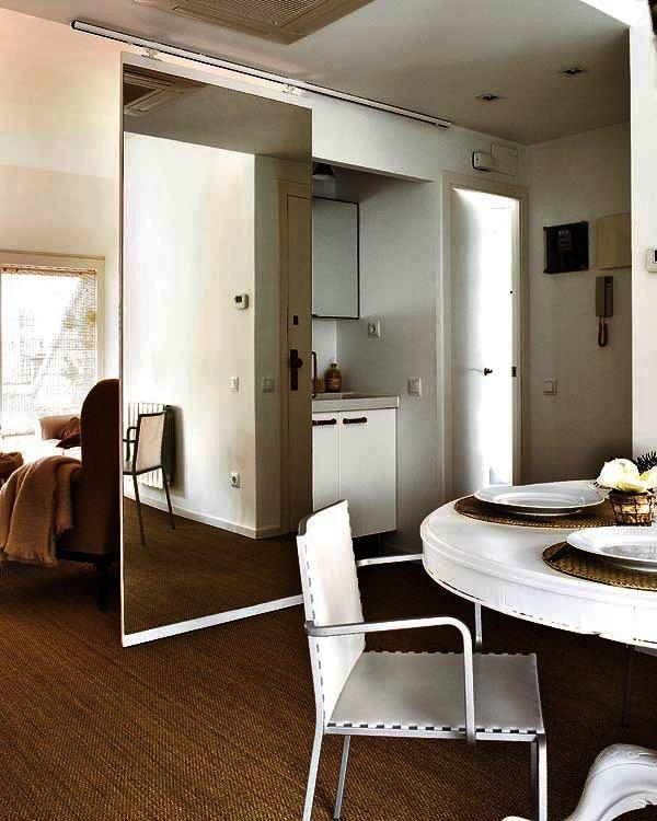 Decorar con espejos la deco tendencia de la era del reflejo for Decoracion de salas con espejos grandes