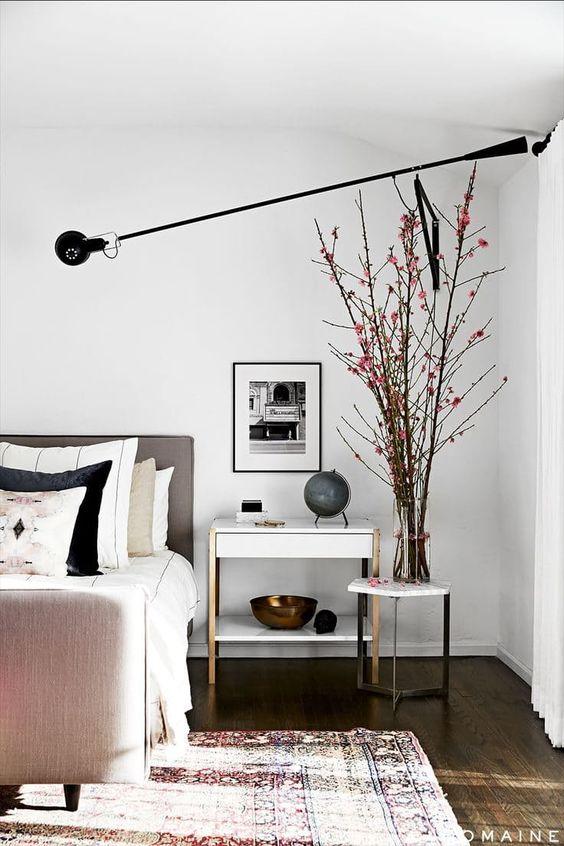 cómo iluminar un dormitorio con apliques de pared